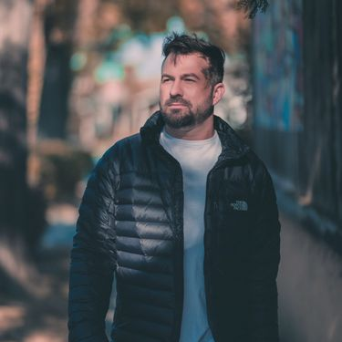 Handsome Adventist single man wearing a black jacket