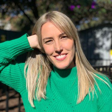 Cute Adventist single blonde woman wearing a green sweater