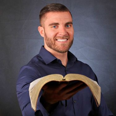Good looking Adventist single man holding a bible
